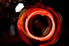 Движение круга высокого разрешения абстрактное накаляя запачкало предпосылку в темная яркая красной, зеленый, желтый, голубой Стоковая Фотография