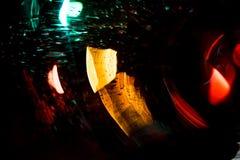 Движение круга высокого разрешения абстрактное накаляя запачкало предпосылку в темная яркая красной, зеленый, желтый, голубой Стоковые Фото
