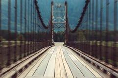 Движение на деревянном мосте взглядом автомобиля Стоковая Фотография RF