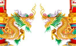 Двойная золотая статуя дракона изолированная на белой предпосылке Стоковая Фотография
