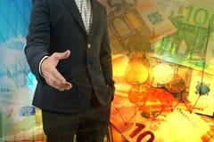 Двойная экспозиция бизнесмена давая его руку для рукопожатия с городским пейзажем и деньгами ЕВРО Стоковые Изображения RF
