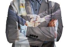 Двойная экспозиция бизнесмена с группой обеспечения соединяет руку или ООН Стоковое фото RF