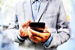 Двойная экспозиция города и бизнесмена на телефоне Стоковые Фото