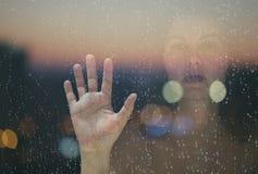 Двойная экспозиция женских руки и стороны и города ночи Дубай Стоковые Фотографии RF