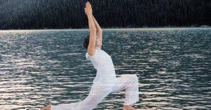 Двойная экспозиция женщины выполняя йогу озером Стоковые Фотографии RF