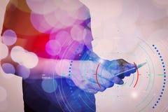 Двойная экспозиция руки бизнесмена используя планшет с c Стоковая Фотография