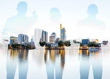 Двойная экспозиция с бизнесменами и современным городским пейзажем стоковое фото rf