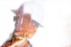 Двойная экспозиция человека инженера или архитектуры в работая shir Стоковая Фотография RF
