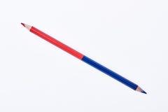 Двойник встал на сторону покрашенный карандаш Стоковое фото RF