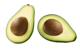 Двойной авокадо половинный при семя изолированное на белизне стоковая фотография