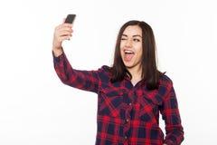 Девочка-подростки делают selfie и подмигивают Стоковые Фото