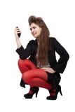 Девочка-подросток в черных и красных одеждах Стоковая Фотография