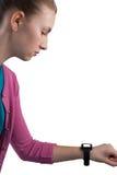 Девочка-подросток смотря ее smartwatch Стоковые Фото