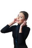 Девочка-подросток с наушниками слушая к музыке Стоковая Фотография RF