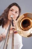 Девочка-подросток с тромбоном стоковые изображения