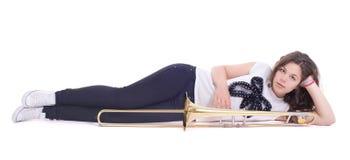 Девочка-подросток с тромбоном стоковое изображение
