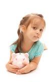 девушка банка держа немногую piggy детеныши Стоковая Фотография