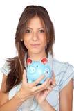 девушка банка красивейшая голубая piggy Стоковая Фотография