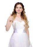 Девушка в белом платье свадьбы, делает tumbs вверх Стоковое фото RF