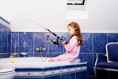 Девушка в ванной комнате стоковые фото