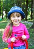 Девушка в голубом шлеме Стоковые Изображения