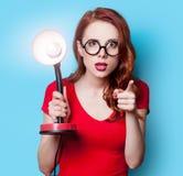 Девушка в красном платье с лампой Стоковая Фотография
