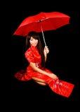 Девушка в красном платье. Стоковое фото RF