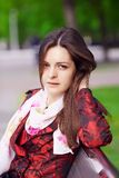 Девушка в красном плаще Стоковое Фото