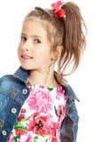 Девушка в куртке джинсовой ткани Стоковая Фотография