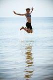Девушка в море стоковое изображение