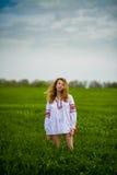 Девушка в национальном платье Стоковое Фото