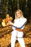 Девушка в осени Стоковые Фото