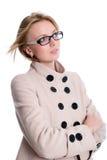 Девушка в пальто смотря к стороне Стоковое Изображение