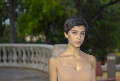 Девушка в парке серьезном Стоковое фото RF