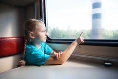Девушка в поезде Стоковая Фотография