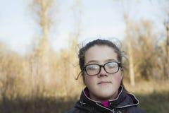 Девушка в пуще осени Стоковая Фотография