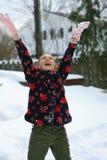 Девушка в снеге стоковые изображения