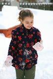 Девушка в снеге стоковые изображения rf