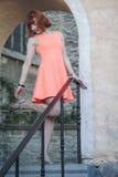 Девушка в старом городке Стоковое Фото