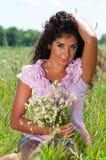 Девушка в траве Стоковая Фотография