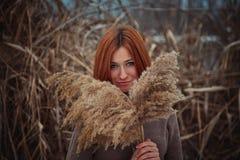 Девушка в тростниках Стоковые Фото