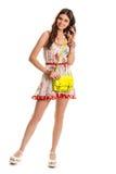 Девушка в усмехаться флористического платья Стоковое фото RF