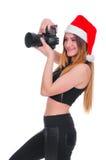 Девушка в шляпе Санта Клауса с камерой Рождество фотографа маленькой девочки Selfie рождества Стоковое Фото