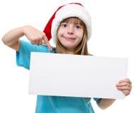 Девушка в шляпе Санты с whiteboard Стоковые Изображения