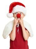 Девушка в шляпе santa при изолированный нос клоуна на белизне Стоковые Изображения
