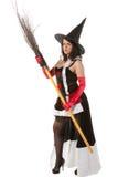 Девушка в costume ведьмы Halloween с веником Стоковое фото RF