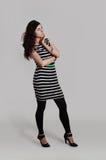 Девушка в striped тунике Стоковая Фотография RF