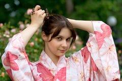 Девушка в yukata цветка Стоковая Фотография