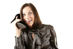 Девушка говоря на телефоне в форме ботинка Стоковая Фотография