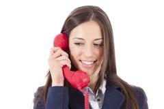 Девушка говоря на телефоне Стоковое Изображение